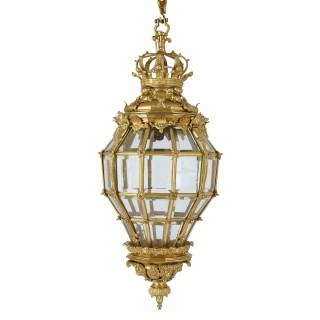 Pair of Louis XVI style gilt bronze and glass lanterns