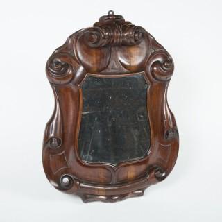 WALNUT SHIELD WALL MIRROR, Italy, circa 1880.