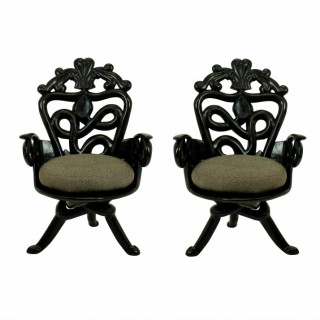 A PAIR OF FRENCH MID-CENTURY SURREALIST ARMCHAIRS