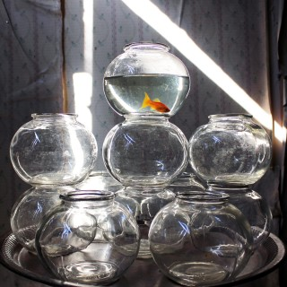 A Group of Seventeen Original 1960's Fairground Glass Goldfish Bowls