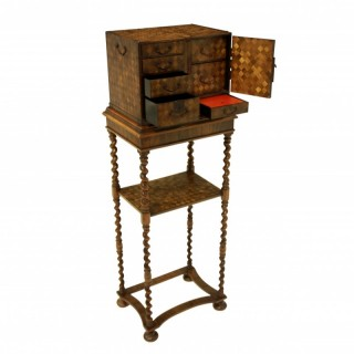 A JAPANESE CABINET ON STAND
