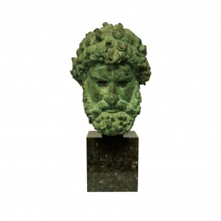 A LIFE SIZE BRONZE HEAD OF ZEUS