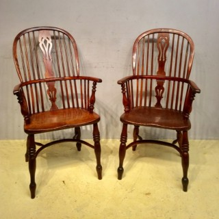 A matched pair of 19th century tall back yew windsor chairs.