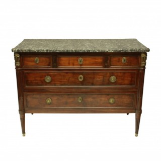 A FRENCH DIRECTOIRE COMMODE IN MAHOGANY WITH GREY MARBLE TOP