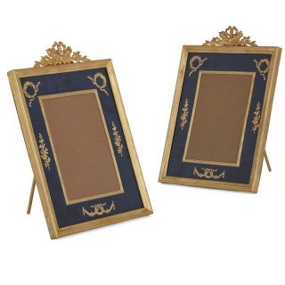 Pair of Neoclassical style gilt bronze and enamel photograph frames