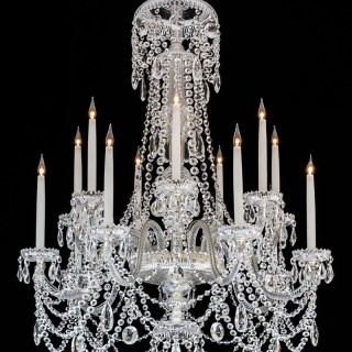 A FOURTEEN LIGHT CUT GLASS CHANDELIER IN THE STYLE OF PERRY & CO