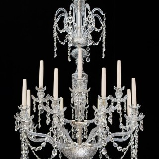 A TWELVE LIGHT EDWARDIAN CUT GLASS CHANDELIER