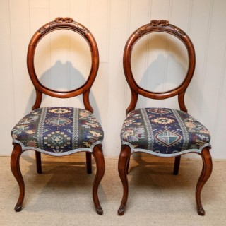Pair Of Walnut Balloon Back Chairs