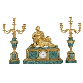 French gilt bronze mounted malachite three-piece clock set by Raingo Frères