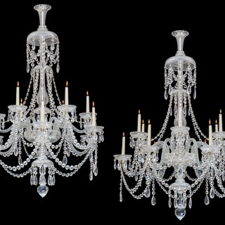 A FINE PAIR OF TWELVE LIGHT CUT GLASS ANTIQUE CHANDELIERS BY PERRY & CO