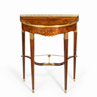 A French demi-lune rosewood bow and arrow table by Georges-François Alix