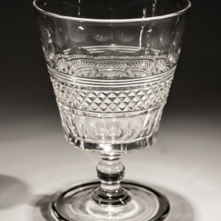 A FINE SET OF FOUR ELABORATE CUT GLASS REGENCY SPIRIT DECANTERS WITH MATCHING GOBLETS