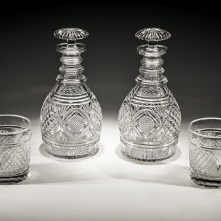 AN EXQUISITE PAIR OF REGENCY CUT GLASS DECANTERS WITH MATCHING TUMBLERS