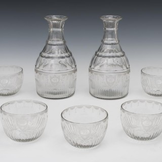 A FINE PAIR OF GEORGIAN MAGNUM CARAFES WITH MATCHING FINGER BOWLS