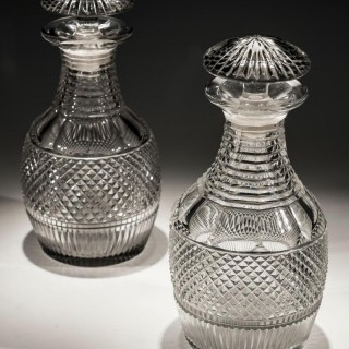 A SUITE OF IRISH CUT GLASS REGENCY DECANTERS AND GOBLETS