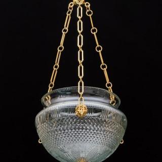 A ORMOLU MOUNTED EMPIRE CUT GLASS BOWL LIGHT