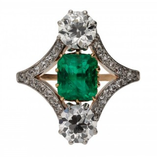 Edwardian Colombian emerald and diamond three stone cluster ring, circa 1910.