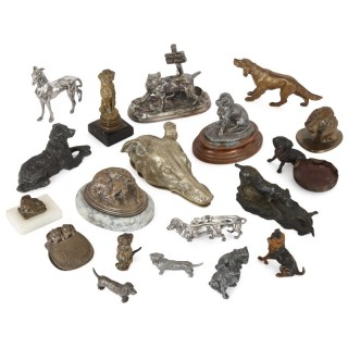 Collection of twenty metal dogs of various types