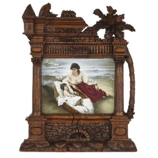 Germain porcelain plaque in ornate carved Black Forest frame