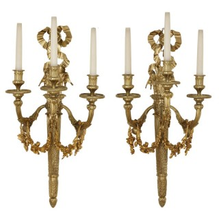 Pair of Neoclassical style gilt bronze three-light sconces