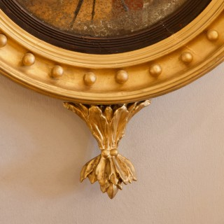 Early 19th Century Regency Eagle Figure Round Giltwood Convex Wall Mirror