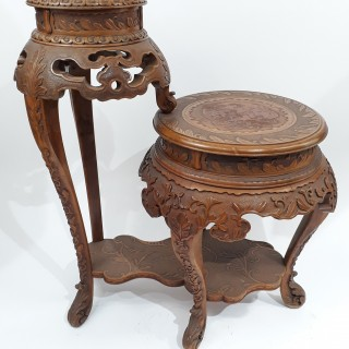 A Japanese two tiered carved wood stand