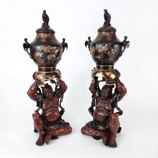 An impressive pair of Japanese bronze nio holding koro