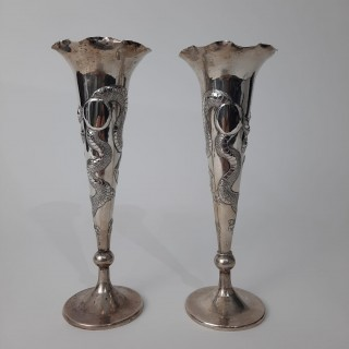 A pair of Chinese silver fluted vases with dragon decoration