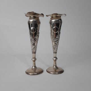 A pair of Chinese silver fluted vases with decoration of Iris