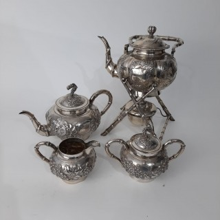 A Chinese silver teapot set with warming stand