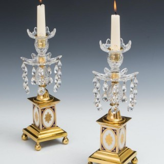 A PAIR OF GEORGE III CANDLESTICKS