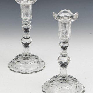 A FINE PAIR OF SCALE & FLAT CUT GEORGIAN CANDLESTICKS