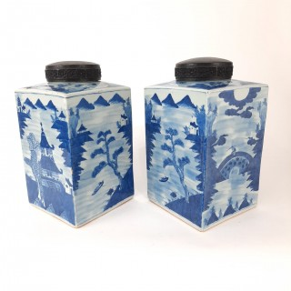 A pair of Chinese blue and white tea jars with wood covers