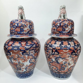 A pair of large Japanese Imari jars and covers