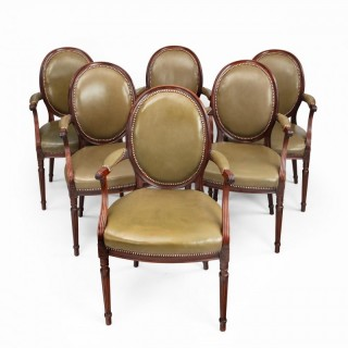 Four Edwardian mahogany chairs by Gill & Reigate