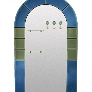 A FLOOR STANDING HALL MIRROR WITH COAT HOOKS
