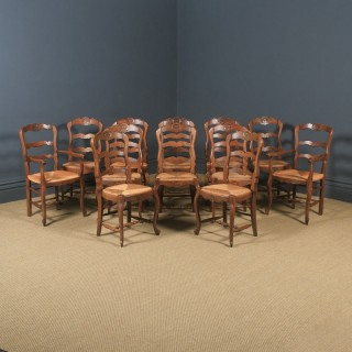 Antique French Set of 12 Louis XV Style Oak Ladder Back Rush Seat Kitchen Dining Chairs (Circa 1920)