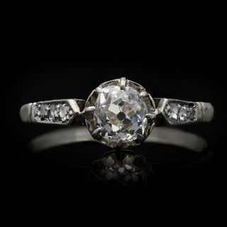 Antique diamond flanked solitaire ring, circa 1920.