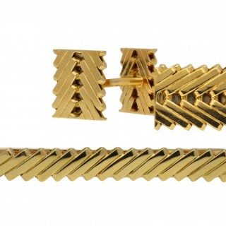 Van Cleef & Arpels gold cufflink and tie pin set, circa 1970.