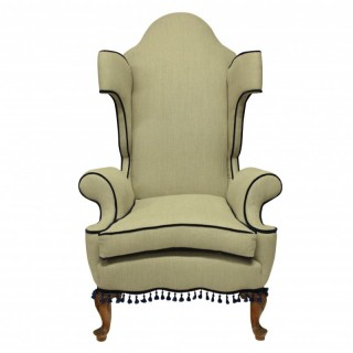 A QUEEN ANNE REVIVAL WING BACK ARMCHAIR