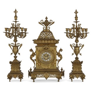 French Régence style gilt bronze clock garniture