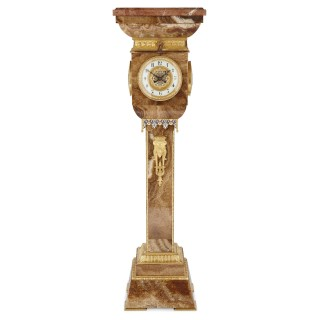 French gilt bronze and enamel mounted onyx standing clock