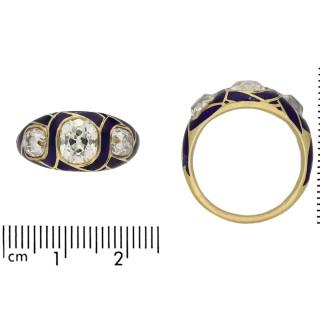 Victorian three stone diamond and blue enamel ring, circa 1890.
