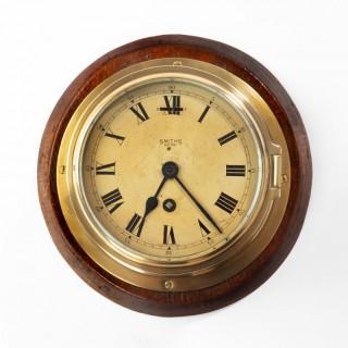 A Smiths Astral brass bulkhead clock