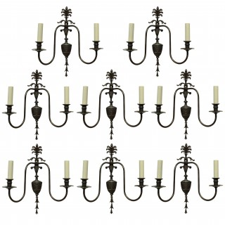 A SET OF EIGHT ADAM STYLE BRONZED WALL SCONCES