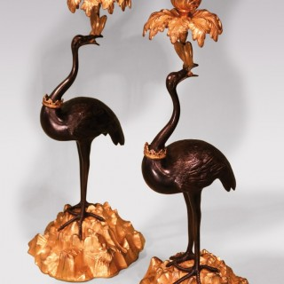 A pair of mid 19th century bronze and ormolu candlestick cranes