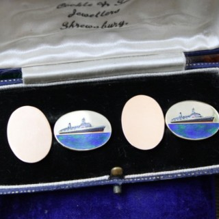 An extremely fine pair of oval 9ct Yellow Gold Enamel Cufflinks celebrating the Queen Elizabeth 1938 - 1966 (Cunard), English, Circa 1969