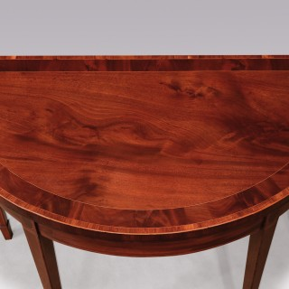 A pair of George III mahogany card tables