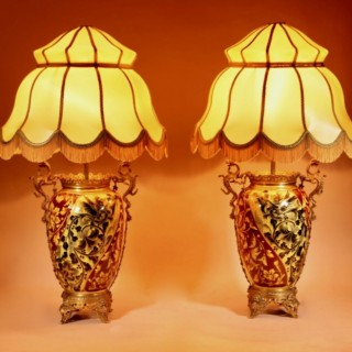 A Pair of Spectacular And Beautiful Ceramic Hand painted Paraffin Lamps.