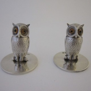A pair of Antique George V Sterling silver owl menu/place card holders